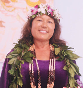 420906ace8fd Elle Cochran dressed in royal purple and was donned with an elegant maile  lei during the August 11 election evening readings. She is shown here  smiling for ...